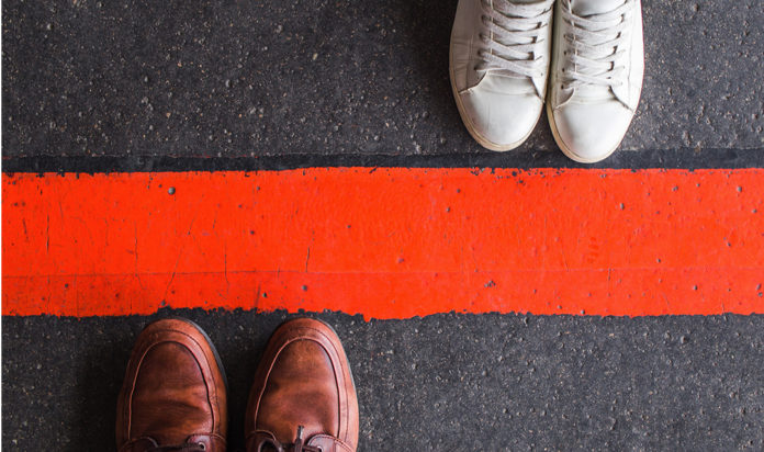 Man and woman divided by a line stock photo