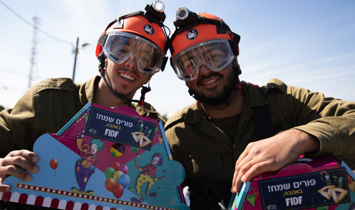 IDF soldiers celebrating Purim with Mishloach Manot from FIDF.