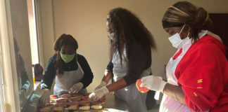 JVS Skill Building participants prepare sandwiches at the Salvation Army.