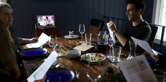 A family celebrates the Passover Seder with other family members joining via Zoom, April 8, 2020.