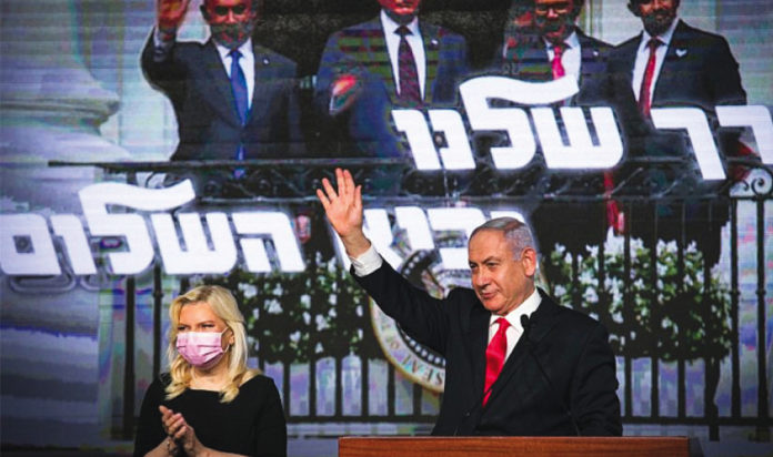 Israeli Prime Minister Benjamin Netanyahu addresses supporters on election night at Likud Party headquarters in Jerusalem, March 23, 2021.