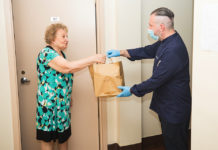 David Teyf delivers a Shabbat meal to a homebound Holocaust survivor in New York City, Aug. 21, 2020.