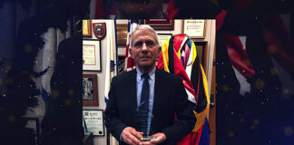 Dr. Anthony Fauci poses with an award from the March of the Living in a broadcast posted by the Holocaust remembrance group, April 7, 2021.