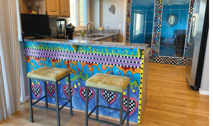 Hillary Levin painted a mural on the kitchen bar of her Commerce home. Each project is hand-painted in acrylic and coated in polyurethane.