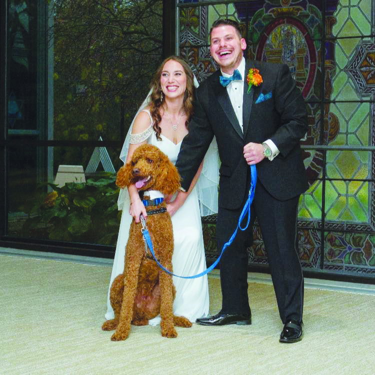 """Elissa and Noah Schechter and their dog Moses, who """"chose"""" their home"""