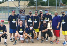 The Temple Israel No. 6 team celebrates its Inter-Congregational Men's Club Summer Softball League Greenberg Division championship last season.