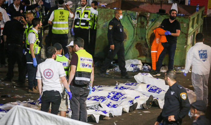 Israeli rescue forces and police at the scene after a mass fatality scene during the celebrations of the Jewish holiday of Lag B'Omer on Mt. Meron, in northern Israel on April 30, 2021.