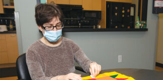 Leslee Milgrom does an arts and craft activity