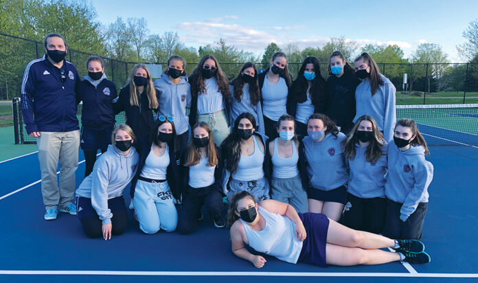 The Frankel Jewish Academy girls tennis team celebrates its Catholic League Intersectional II division championship last week after beating Riverview Gabriel Richard at Drake Sports Park in West Bloomfield.