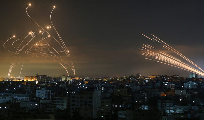 The Iron Dome interceptors (left) meet a volley of missiles from Gaza (right) on May 14, 2021.