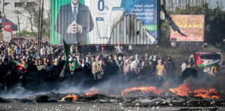 Palestinians clash with Israeli security forces near the Hawara checkpoint, south of Nablus in Samaria, May 18, 2021.