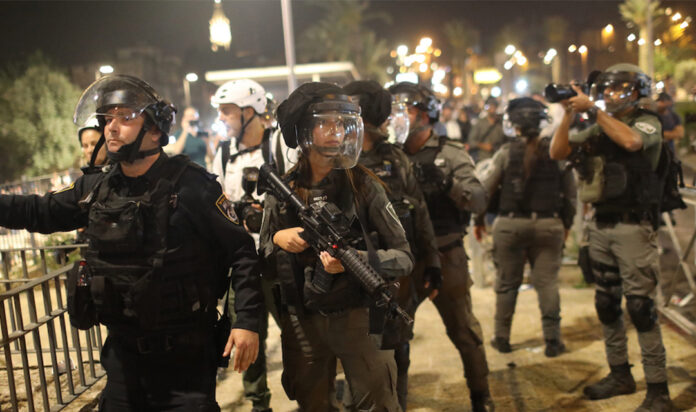 Israeli security forces deploy during a demonstration against the planned eviction process in the Sheikh Jarrah neighborhood.