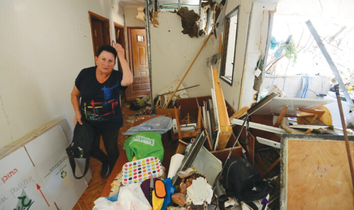 An Israeli in her home after a rocket hit from the Gaza Strip, in the southern city of Ashdod, on May 18, 2021.