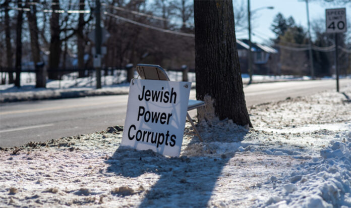 A protestor's sign outside the synagogue.