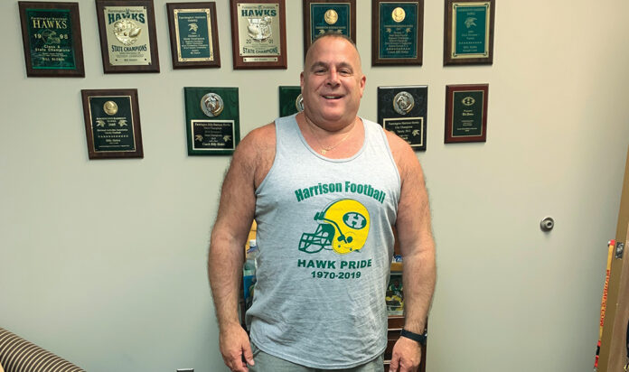Billy Slobin's allegiance to Farmington Hills Harrison is easy to see in his office, which is across West 12 Mile Road from the former high school.