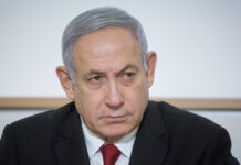 Prime Minister Benjamin Netanyahu, seen on Nov. 12, 2019, came in for criticism over the Meron tragedy, dealing another blow to his coalition-building hopes.