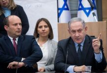 Naftali Bennett, left, then Israeli defense minister, looks on at then-Prime Minister Benjamin Netanyahu during a meeting of right-wing parties, March 4, 2020.