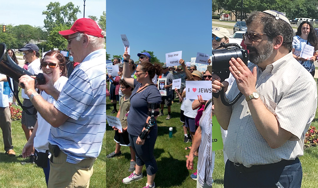 """CLOCKWISE: Carolyn Normandin details the ADL's efforts while Eugene Greenstein assists with the megaphone. Demonstrators hold signs that read """"Stop Jew Hatred"""" and """"Proud to Be Jewish."""" Rabbi Asher Lopatin of JCRC/AJC says, """"We stand together."""""""