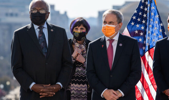 From left, House Majority Whip Jim Clyburn, D-S.C., Reps. Rosa DeLauro, D-Conn., John Yarmuth, D-Ky., and Pete Aguilar, D-Calif., on the West Front of the Capitol on Wednesday, March 10, 2021. DeLauro and Yarmuth, who are members of the House leadership, called on President Biden to revers Trump administration Middle East policies.