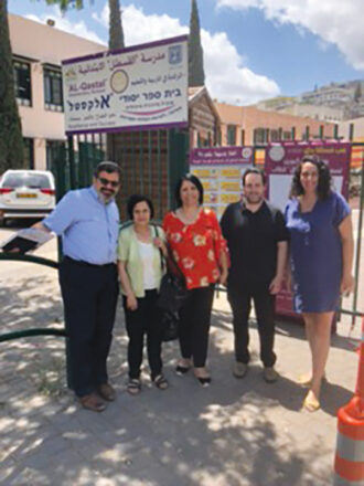 """In front of the Arab Israeli elementary school, Al-Qastal in Nazareth with Samia Basul, head of the Education Department of Nazareth; Samia Abu-Alrab, Deputy Mayor of Nazareth; Lior Scher, programming director for """"A New Way,"""" which sponsored the shared society; and Noa Noff, Partnership Director, Central Galilee."""