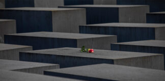 A rose is placed on the Holocaust Memorial on the International Holocaust Remembrance Day on January 27, 2021 in Berlin, Germany.