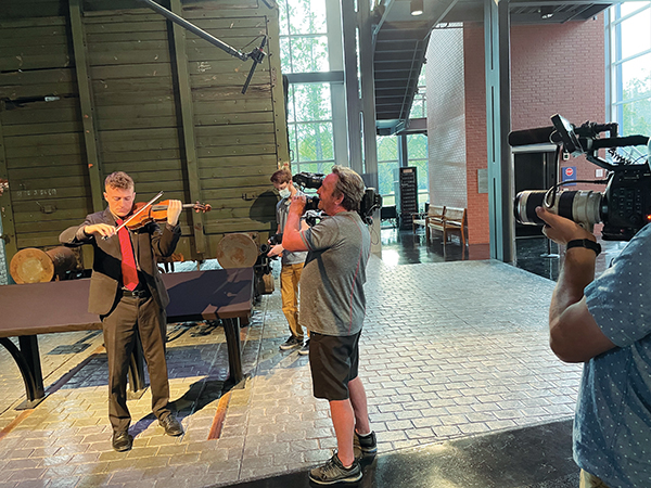 Violinist Nathan Bieber plays his instrument during the filming of the Holocaust memorial film for PBS.