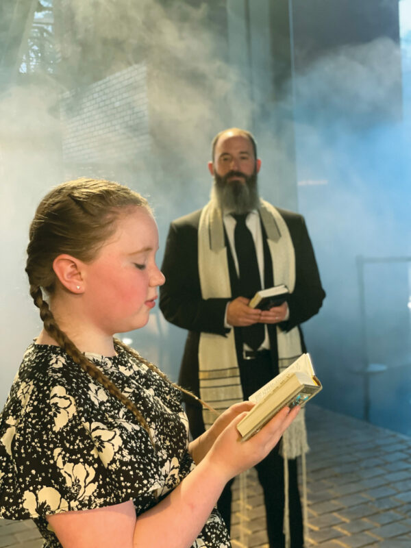 """Zosia Gross, 9, recites the English version of the Jewish prayer """"Eil Malei Rachamim"""" while her father, Hazan Daniel Gross, sings in Hebrew with Cantors Neil Michaels and Pamela Schiffer, and Cantorial Soloists Kelly Onickel and Stephanie Michaels."""