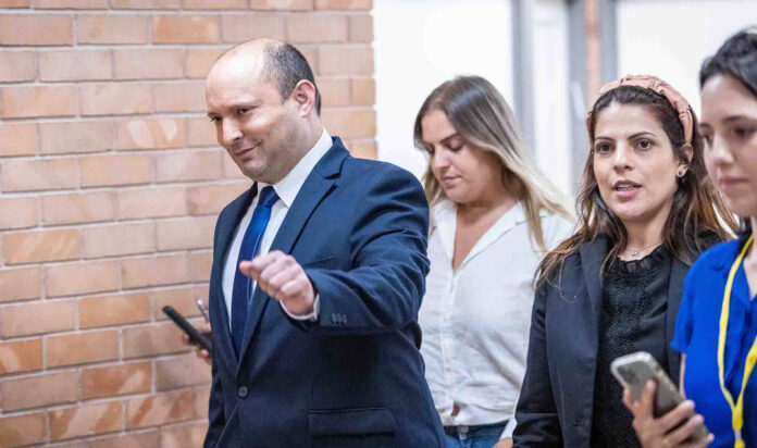 Naftali Bennett on his way to announce in a press conference at the Knesset, the Israeli parliament in Jerusalem, that he will join Yair Lapid's coalition, May 30, 2021.