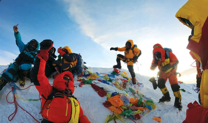 Singer-songwriter Mike Posner, a former Detroiter, and his expedition team reach the top of Mount Everest.