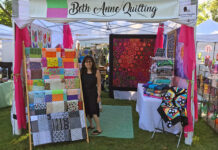 Fiber artist Beth Rosenfeld is surrounded by her beautiful quilts at Franklin's Art in the Village in 2019.