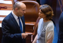 Naftali Bennett, left, and Tamar Zandberg in the Israeli parliament, June 2, 2021. Both have been targeted by death threats due to their opposition to Prime Minister Benjamin Netanyahu, who is trying to remain in power.