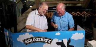 Ben & Jerry's co-founders Jerry Greenfield, left, and Ben Cohen serve ice cream following a press conference announcing a new flavor in Washington, D.C., Sept. 3, 2019.