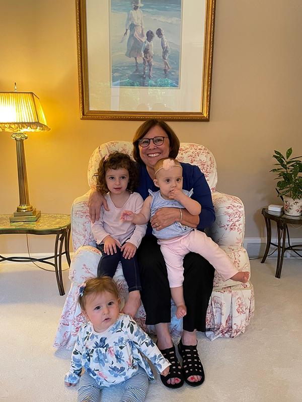 Debra Silver with her three granddaughters, Mia Paige Silver, 3, and Isabella Faye Silver, 10 months (on left), and Eloise Margot Cherluck, 11 months