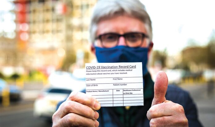 Man with Vaccine Card