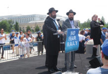 Shlomo Noginski, a rabbi who was stabbed in Boston, speaks to a rally against antisemitism at the U.S. Capitol in Washington, D.C., July 11, 2021.