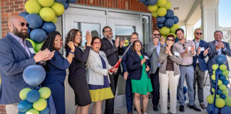 Rabbi Yisrael Pinson (center) and guests at the ribbon-cutting for the Orchard Academy.