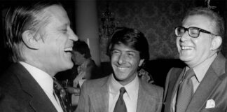 """Washington Post Executive Editor Ben Bradlee, left, and Dustin Hoffman, center, laugh with Harry Rosenfeld at the premiere of """"All the President's Men"""" at the Kennedy Center in Washington, D.C., in 1976."""