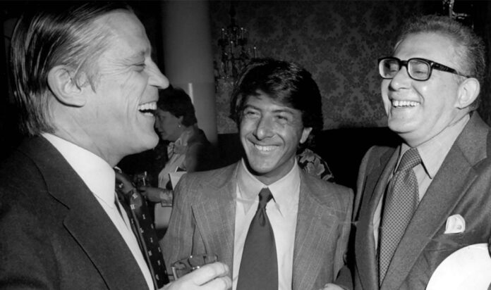 Washington Post Executive Editor Ben Bradlee, left, and Dustin Hoffman, center, laugh with Harry Rosenfeld at the premiere of