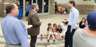 Members enjoy the day together outside the YIOP synagogue building.