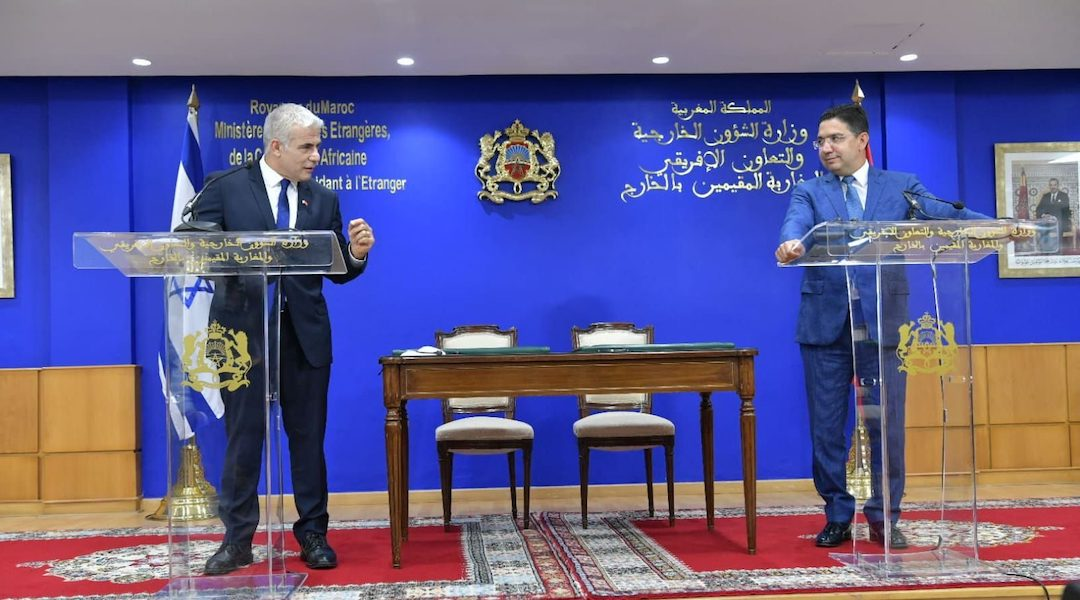 Israeli Foreign Minister Yair Lapid, left, confers with Nasser Bourita, his Moroccan counterpart in Rabat, Morocco, Aug. 11, 2021.