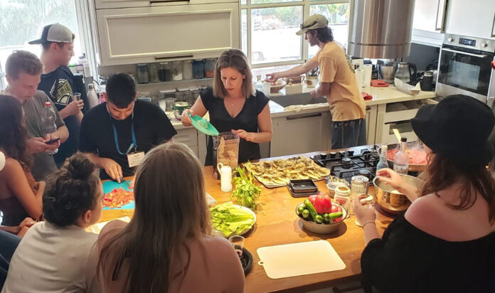 """During """"hospitality experiences,"""" like this hummus-making activity in a private home, Israeli Birthright participants bring their Diaspora Jewish counterparts into their homes, workplaces or army bases to offer a more authentic view of what their personal lives are like."""