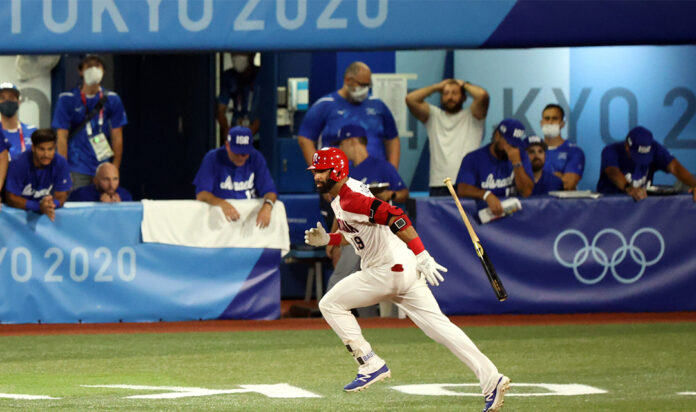 Members of Team Israel react with dismay as a player from the Dominican Republic hits a game-winning single to knock Israel's baseball team out of competition in the Tokyo Olympics, Aug. 3, 2021.