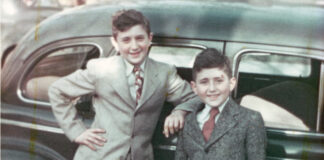 The Levin brothers, Sandy, 9, and Carl, 6, by the family Pontiac in Detroit