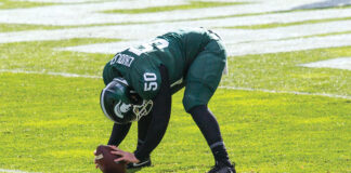 Michigan State's Nick Chudler works on his long-snapping before a 2018 game against Michigan at Spartan Stadium.