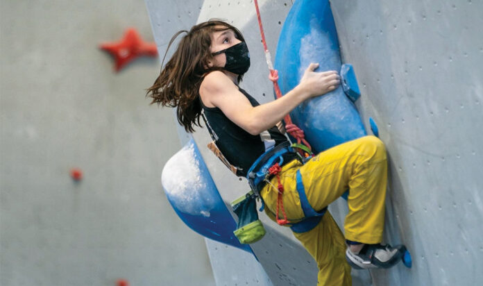Nate Emery is laser-focused on his next move in the sport climbing semifinals at the USA Climbing national competition.