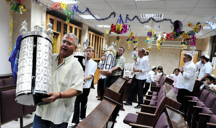 Israelis celebrate Simchat Torah by dancing with the scrolls at a synagogue in Sderot, the town that has been a frequent target of Hamas rocket attacks from nearby Gaza.