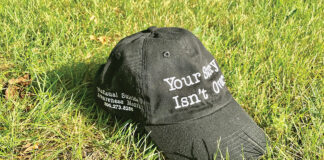 """Brecher and Stone's hat for suicide awareness reads in white letters """"Your story isn't over"""" on the black baseball cap's front logo."""
