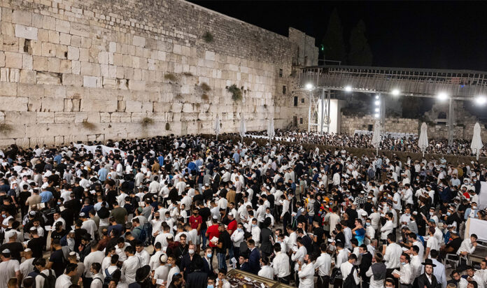 Jews pray for forgiveness, or selichot, at the Western Wall in the Old City of Jerusalem, a day before the Jewish New Year, Sept. 5, 2021