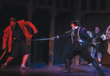 A sword fight choreographed by Steve Sussman