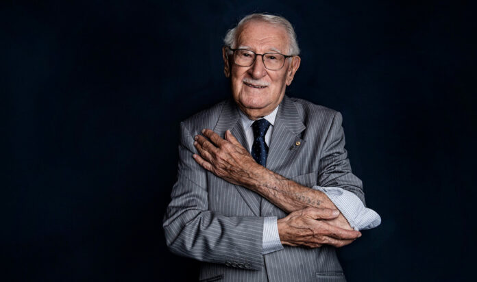 Eddie Jaku shows the concentration camp number tattoo on his left arm, in a photo shoot, July 2, 2020.